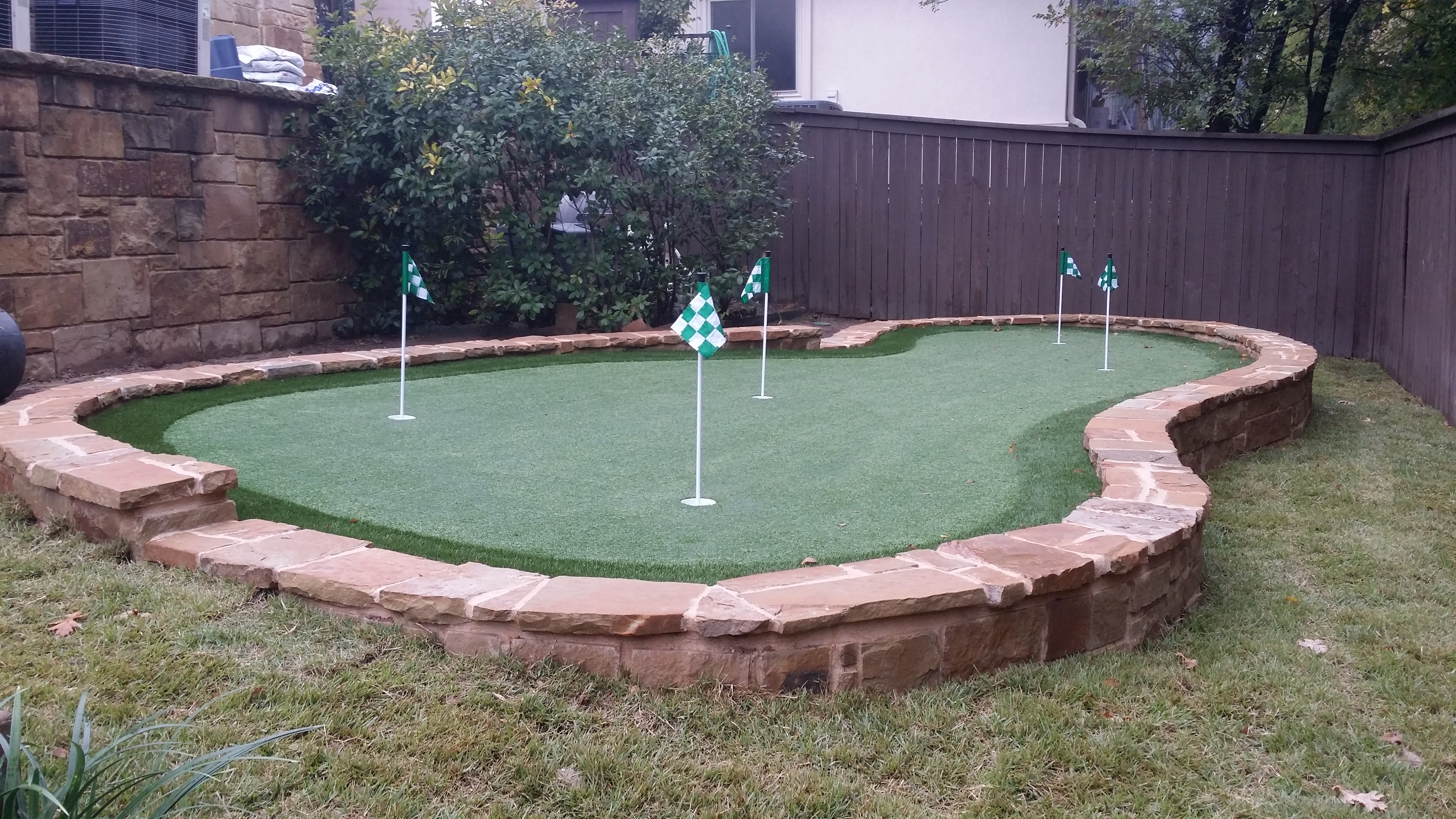 Designing and Installing a Backyard Putting Green ... on Putting Green Ideas For Backyard id=88218