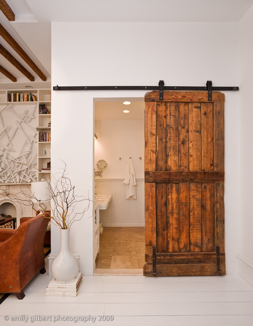 Sliding barn doors add personality to our clients new pantry bathroom with barn door eventshaper