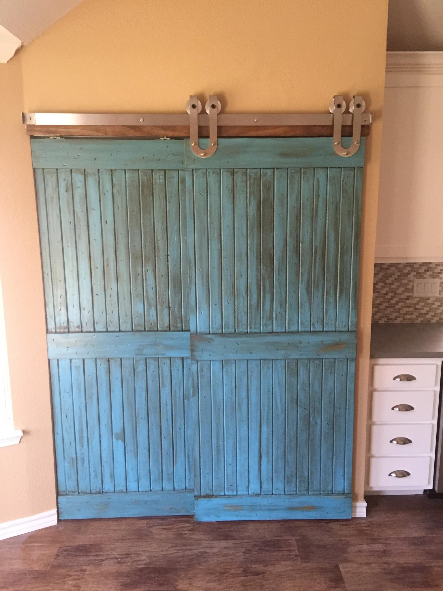 Sliding barn doors add personality to our client s new for Sliding pantry doors