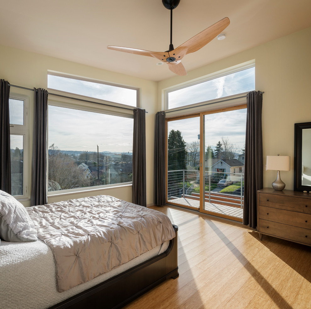 Bright-Haiku-Fan-convention-Seattle-Contemporary-Bedroom-Remodeling-ideas-with-balcony-deck-bamboo-hardwoods-bed-bedding-ceiling-fans-curta
