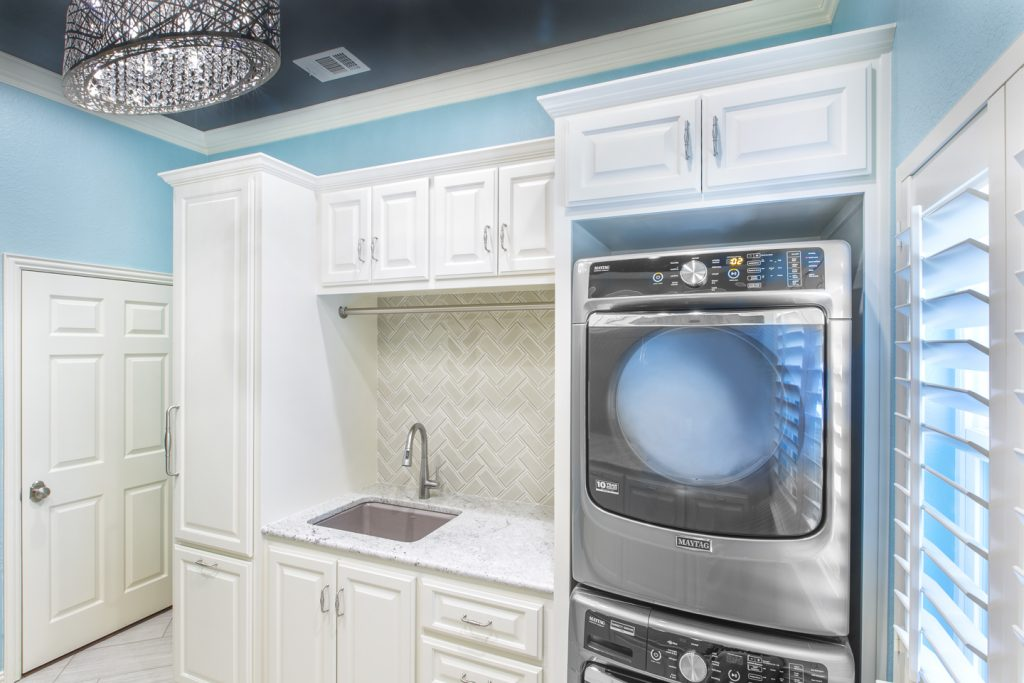 from striped wallpaper to caribbean blue glam: a dream laundry room