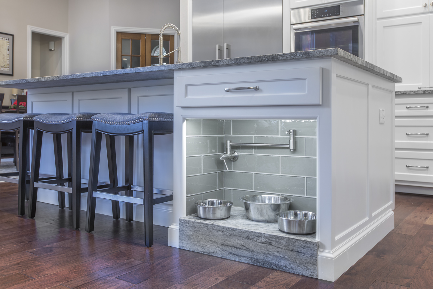 Kitchen island with custom built-in doggie station.