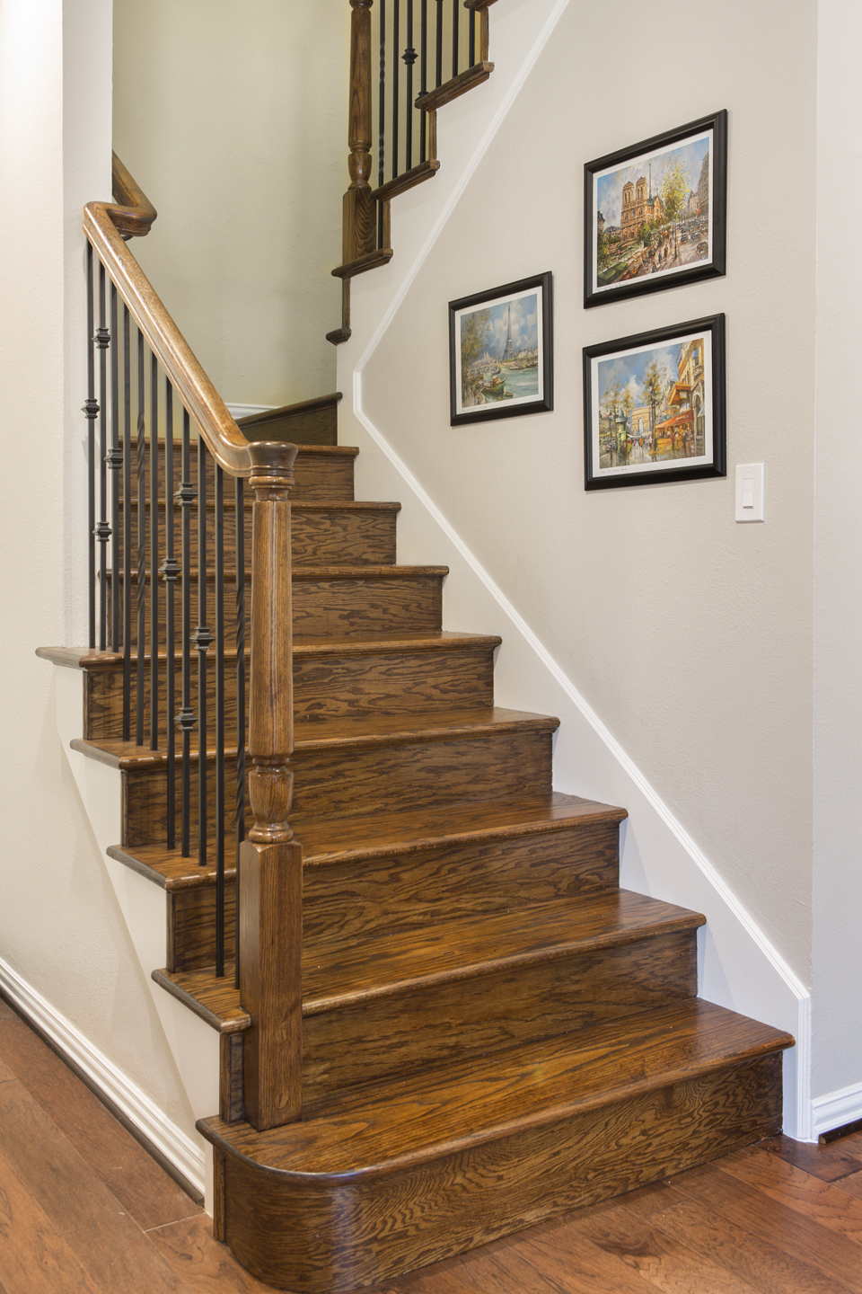 Remodeled staircase with decorative railing.